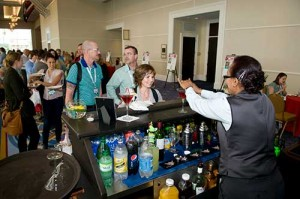 Attendees Enjoy a Drink at the Welcome Reception